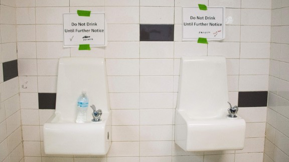 Placards posted above water fountains warn against drinking the water at Flint Northwestern High School in Flint, Michigan, May 4, 2016.