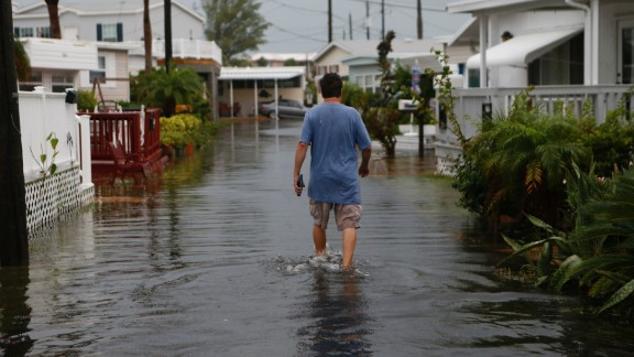A Holmes Beach resident walks through the Sandpiper Resort on September 1.