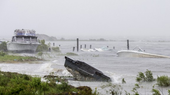 Sunken and beached boats line the shore in Eastpoint on September 1.