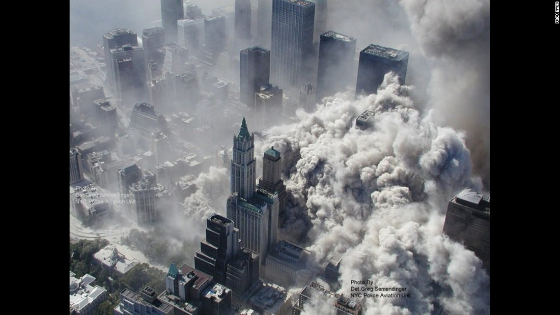 A massive cloud of smoke and debris fills lower Manhattan after the north tower crumbled.