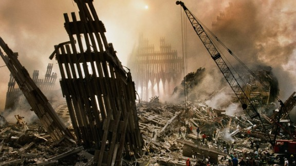 Cleanup crews are seen -- in Steve McCurry's photo -- beginning to clear a mountain of wreckage from the collapse of the towers.