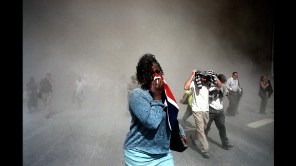 People use masks made out of clothing to protect themselves from dust after the collapse. (Gilles Peress)