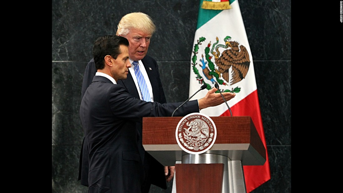 "Mexican President Enrique Peña Nieto, left, welcomes U.S. presidential candidate Donald Trump during a meeting in Mexico City on Wednesday, August 31. They discussed the wall that Trump vowed to build on the U.S.-Mexico border, but Trump said they didn't talk about his demand that Mexico pay for it -- <a href=""http://www.cnn.com/2016/08/30/politics/donald-trump-enrique-pea-nieto-mexico/index.html"" target=""_blank"">an assertion the Mexican President later disputed.</a>"