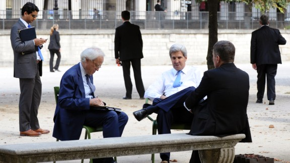 Kerry talks with Charles Rivkin, then US ambassador to France, and Martin Indyk, then special envoy for Israeli-Palestinian negotiations, in 2013 in Tuileries Garden in Paris.