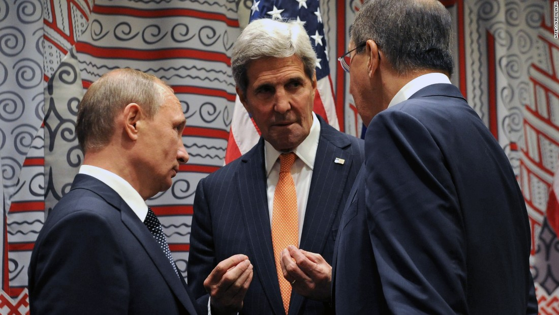 Kerry speaks with Russian President Vladimir Putin, left, and Foreign Minister Sergey Lavrov at the United Nations in 2015.