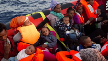 Migrant twins born at sea