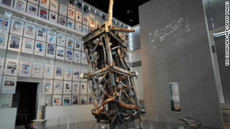 "TO GO WITH AFP STORY: US-MEDIA-CULTURE-MUSEUM BY Chris LEFKOW The mangled tv antenna from the World Trade Center anchors the 9/11 exhibit with a wall of that days front pages from around the world at the new Newseum building on April 1, 2008 in Washington, DC.  A shrine to journalism which traces the history of the news, the new attraction was built at a cost of 450 million USD and bills itself as the ""World's Most Interactive Museum"" and opens its doors to the public this week.   AFP PHOTO / TIM SLOAN (Photo credit should read TIM SLOAN/AFP/Getty Images)"