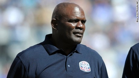 Former New York Giants' Lawrence Taylor during a happier day: at a 25 year anniversary celebration at halftime during a game against the Atlanta Falcons. He was  arrested Friday in Florida on a DUI charge.