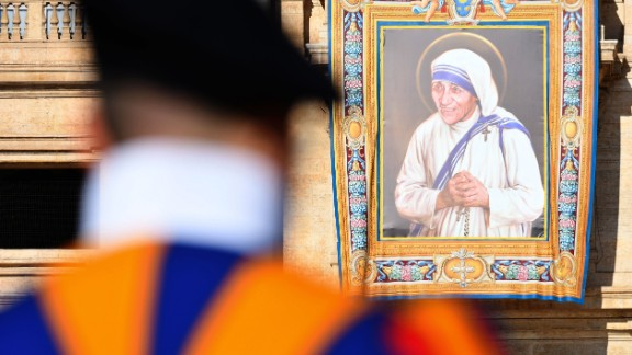 A tapestry with a portrait of Mother Teresa hangs on the facade of St. Peter