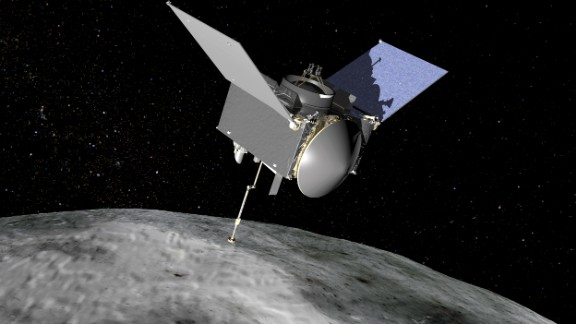 An artist's concept of what the OSIRIS-REx spacecraft looks like as it orbits asteroid Bennu.