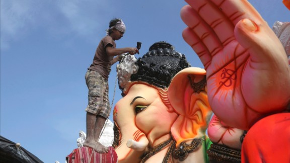 An Indian artist provides final touches to an idol of the elephant-headed Hindu god Ganesha before it is carried off for worship during Ganesh Chaturthi festival, in Hyderabad, India, on Monday, September 5. The Ganesh Chaturthi festival, a popular 10-day religious festival celebrated across India, runs this year from September 5-15 and culminates with the immersion of idols of Ganesh in the Arabian Sea and other local water bodies.