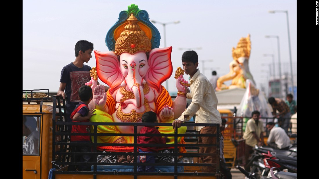 Men carry an elephant-headed idol to worship during the Ganesh Chaturthi festival, in Hyderabad, India on September 5.