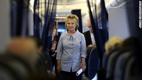 Hillary Clinton greets staff aboard her new campaign plane at Westchester County Airport on September 5, 2016, in White Plains, New York.