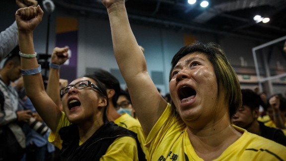 Supporters cheer as the results of Hong Kong