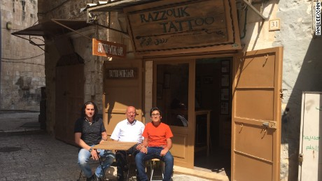 Three generations of Razzouks outside their shop