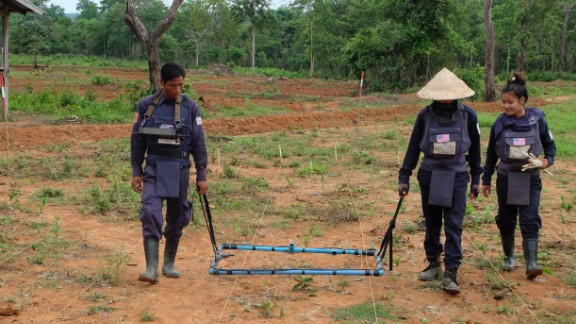 The HALO Trust is the world's largest humanitarian mine clearance organization. It works in Laos to clear unexploded ordnance. Here, two HALO technicians use a Large Loop Detector to clear a hazardous area.