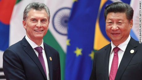 Argentina's President  Mauricio Macri shakes hands with China's President Xi Jinping (R) before the G20 leaders' family photo in Hangzhou on September 4, 2016.  World leaders are gathering in Hangzhou for the 11th G20 Leaders Summit from September 4 to 5. / AFP / Greg BAKER        (Photo credit should read GREG BAKER/AFP/Getty Images)