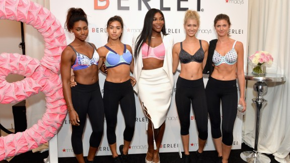 Serena Williams poses with models during a sports bra launch at Macy
