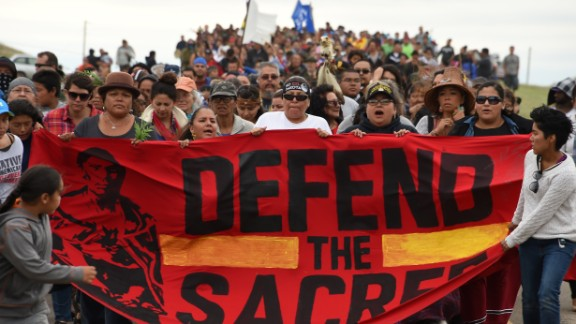 Native Americans march in 2016 to a burial ground site they say was disturbed by pipeline bulldozers.