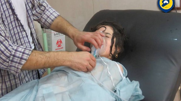 In this still from a video, a girl is treated at a makeshift hospital after the suspected chemical attack.