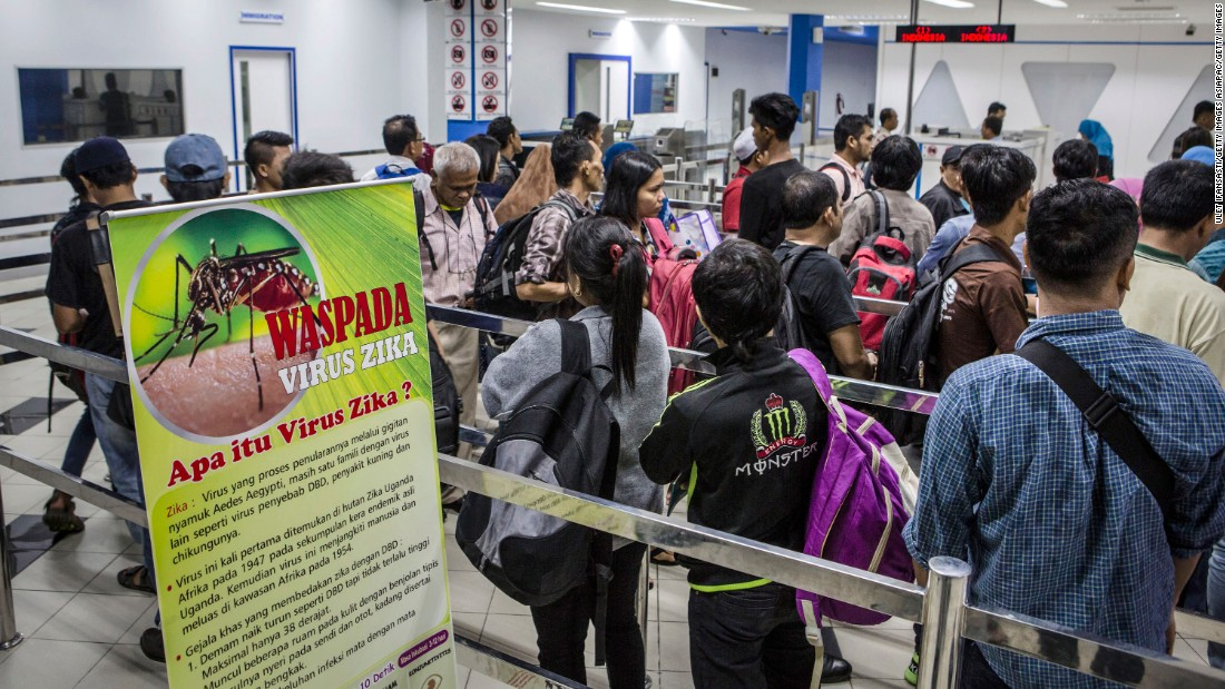 "A banner about Zika virus is seen as ferry passengers <a href=""http://www.cnn.com/2016/09/05/health/zika-asia-threat/"" target=""_blank"">arriving from Singapore</a> get in line at the immigration check on September 4, in Batam, Indonesia."
