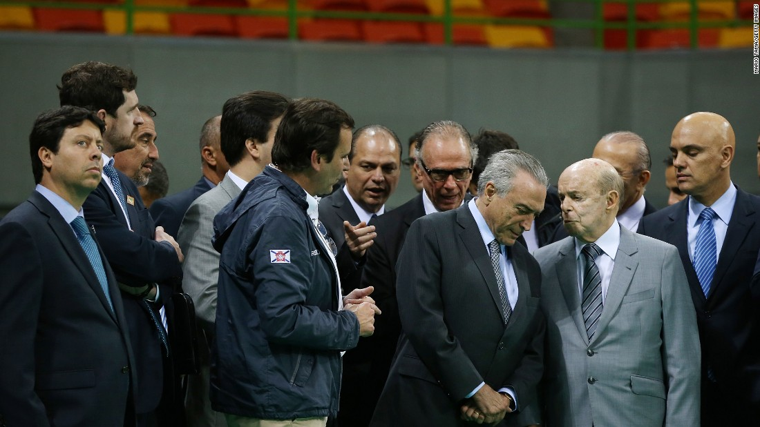 Brazil's interim President Michel Temer, center right, meets with officials during Temer's first visit to the Olympic Park on Thursday, June 14, in Rio de Janeiro. The Rio 2016 Olympic Games commence August 5 amid a political and economic crisis in the country along with the Zika virus outbreak.