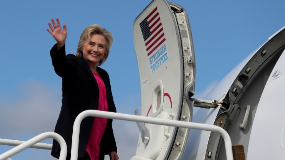 Democratic presidential nominee former Secretary of State Hillary Clinton waves as she boards her campaign plane at Westchester County Airport on September 6, 2016 in White Plains, New York. Clinton will be campaigning in Florida.  (Photo by Justin Sullivan/Getty Images)