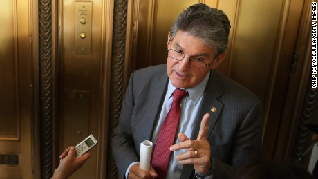 Sen. Joe Manchin (R-WV) talks to reporters after attending a Senate bipartisan lunch in the Russell Senate Office Building on Capitol Hill February 4, 2015 in Washington, DC.