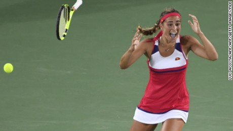 Monica Puig falls to her knees having beaten an opponent ranked 34 places above her.