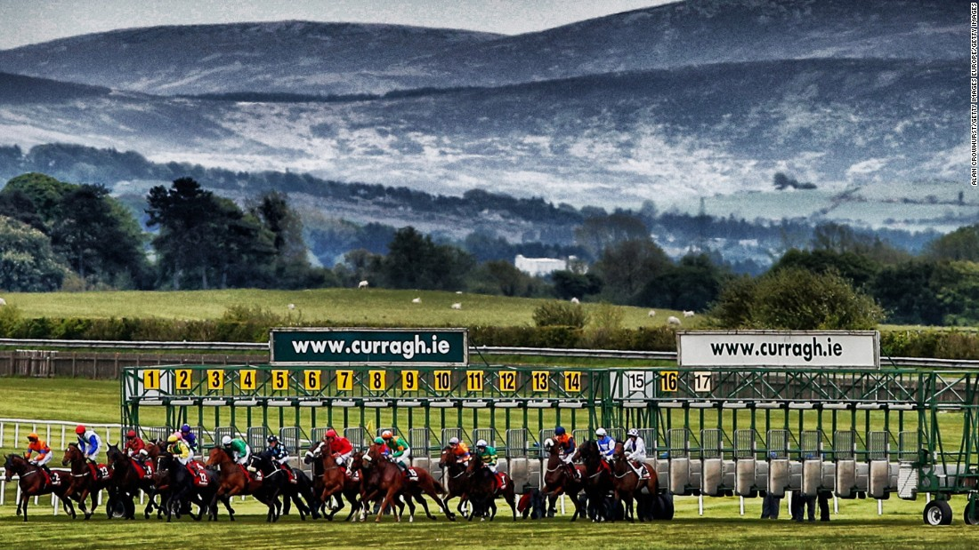 The magical backdrop to the Curragh is seen as jockeys ready themselves for the off at a race in May 2015.