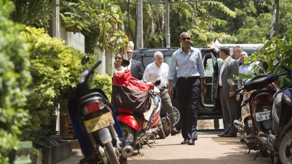 US President Barack Obama walks to shop for gifts in Luang Prabang on September 7, 2016.