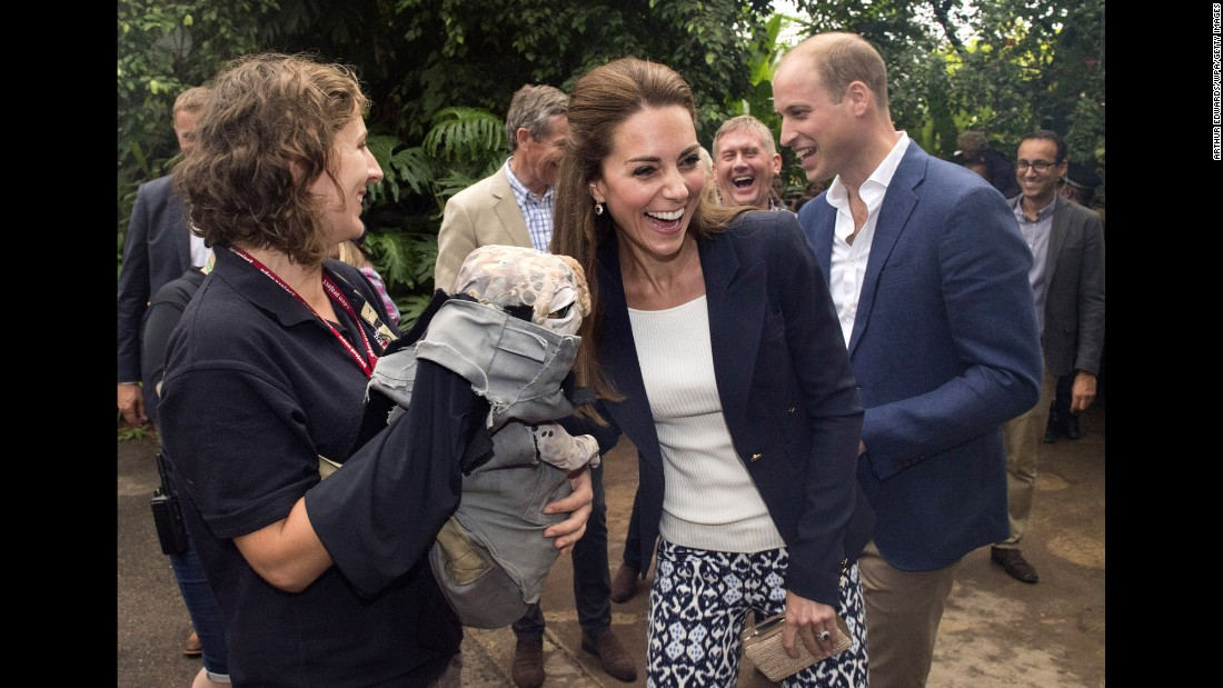 Catherine, Duchess of Cambridge, and Prince William are greeted by a baby dinosaur puppet upon their arrival at the Eden Project in Cornwall, England, on Friday, September 2.