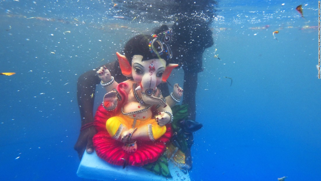 A model of the Hindu god Ganesha is submerged in a pond during a festival in Mumbai, India, on Tuesday, September 6. The elephant-headed Ganesha is revered as a remover of obstacles.