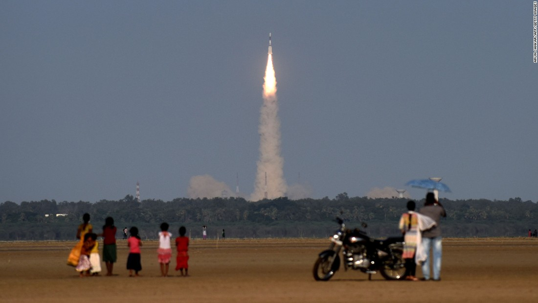 People watch as an Indian Space Research Organization satellite launches from Sriharikota, India, on Thursday, September 8.