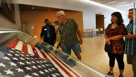 "NEW YORK, NY - SEPTEMBER 08:  The American flag that was raised by firefighters above the site of the 9/11 attacks on the World Trade Center in New York on 2001 is displayed for the first time at the National September 11 Memorial & Museum after turning up in Washington state two years ago on September 8, 2016 in New York City. The flag was made iconic in a photo of firefighters raising it on the day of the attacks. The flag disappeared from Ground Zero during the site cleanup and was mysteriously turned into a police department by a man who gave his name only as ""Brian"". Sunday is the 15th anniversary of the terror attacks.  (Photo by Spencer Platt/Getty Images)"