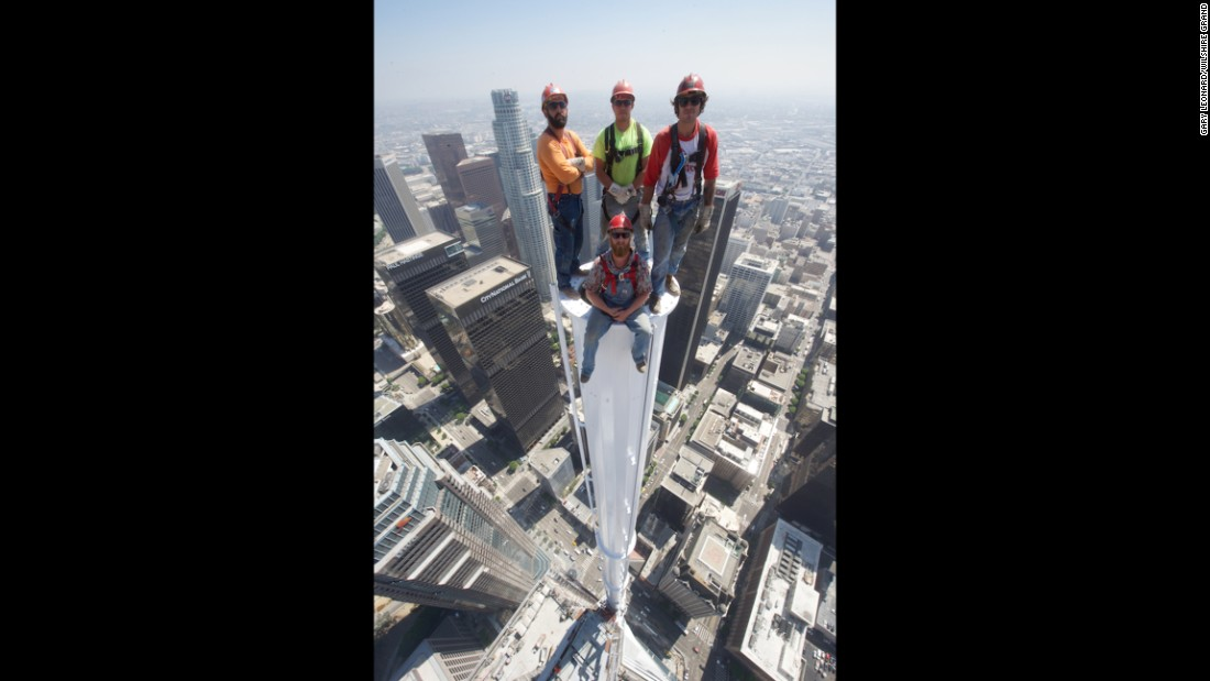 The iron workers responsible for building this spire on the Wilshire Grand Center in Los Angeles posed atop it in a jaw-dropping photo on Saturday.<br />