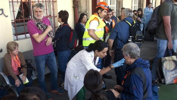 Spanish emergency service workers tend to injured passengers near O Porrino.