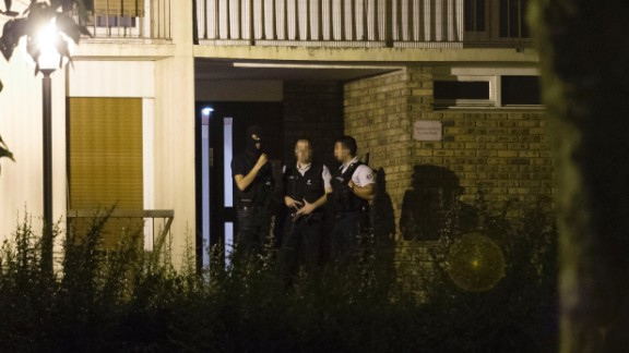 Police appear outside a building Thursday in Boussy-Saint-Antoine  after the arrest of female suspects.