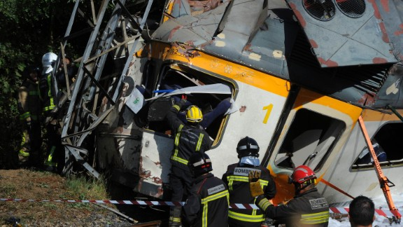 Firefighters and rescuers search for victims of the train derailment.