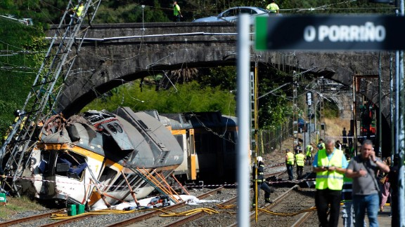 First responders work at the scene of a train derailment near O Porrino station in northwestern Spain's Galicia region on Friday, September 9. At least four people were killed and nearly 50 others injured in the crash, authorities said.
