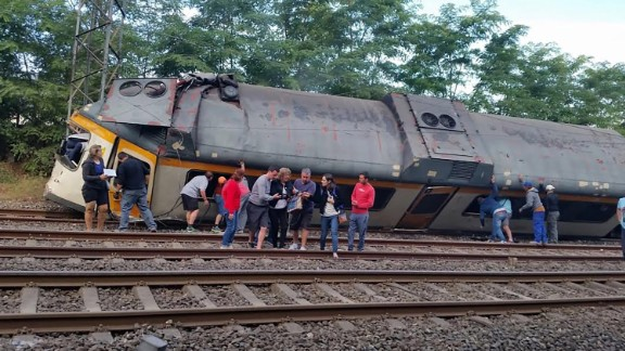 Injured passengers receive help as they move away from the wreckage. The train was en route from Vigo, Spain, to Oporto, Portugal, when the derailment occurred.