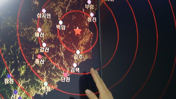 An official of the Earthquake and Volcano of the Korea Monitoring Division points at the epicenter of seismic waves in North Korea, in Seoul, South Korea, Friday, Sept. 9, 2016. South Korea