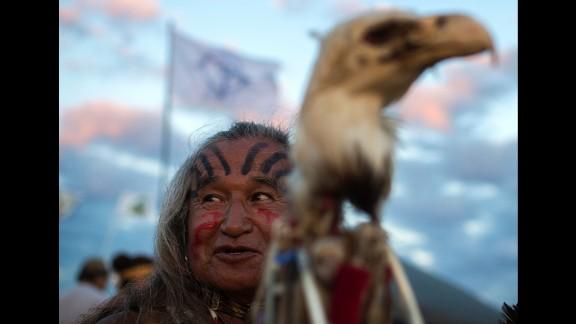 Phil Little Thunder Sr. attends an evening gathering at an encampment of Dakota Access Pipeline protesters on September 3.