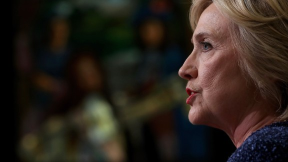 Democratic presidential nominee former Secretary of State Hillary Clinton speaks with reporters following a National Security Working Session at the New York Historical Society Library on September 9, 2016 in New York City.