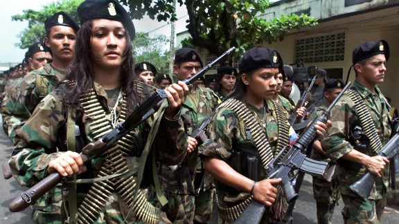 FARC guerrillas march in a military parade in San Vincente, Colombia, in 2001.