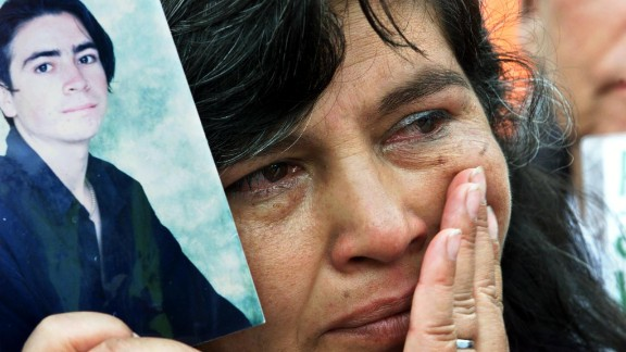 A mother holds a photo of her kidnapped son at a demonstration in Bogota in 2001.