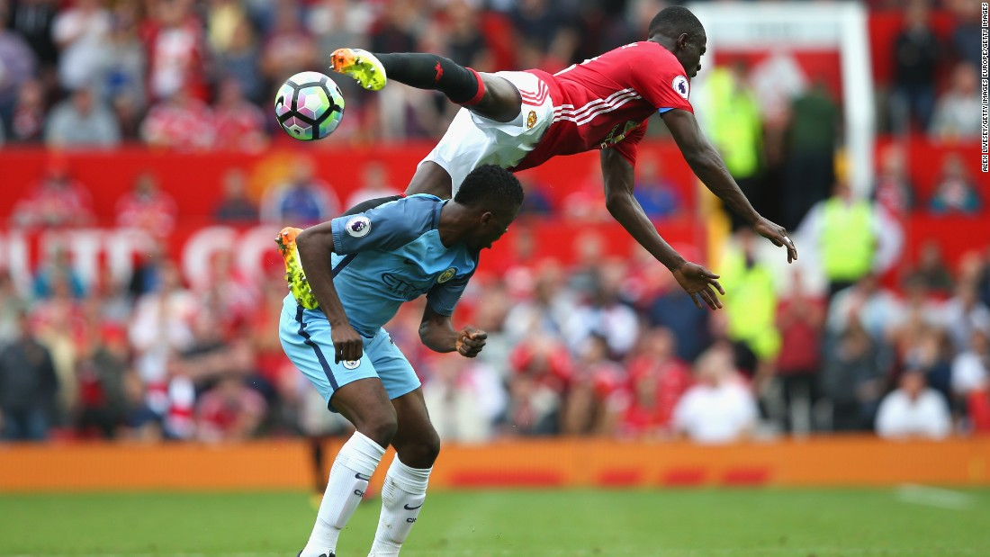 Kelechi Iheanacho of Manchester City and Eric Bailly of Manchester United battle for possession in the air during the Premier League match between Manchester United and Manchester City at Old Trafford on September 10, 2016 in Manchester, England.