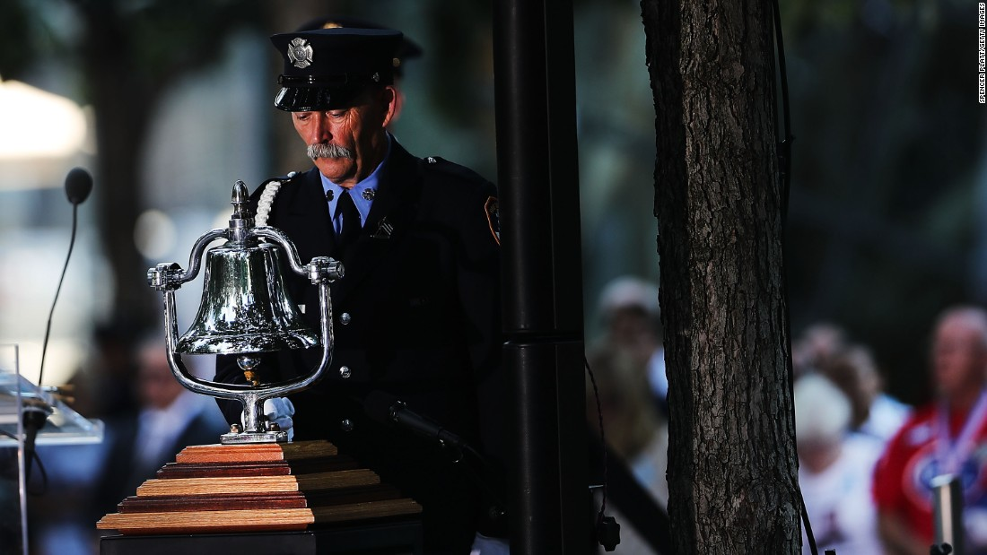 A firefighter rings a bell as family members, emergency workers and others attend a commemoration ceremony for the victims of the September 11 terrorist attacks at the National September 11 Memorial and Museum on Sunday in New York City.