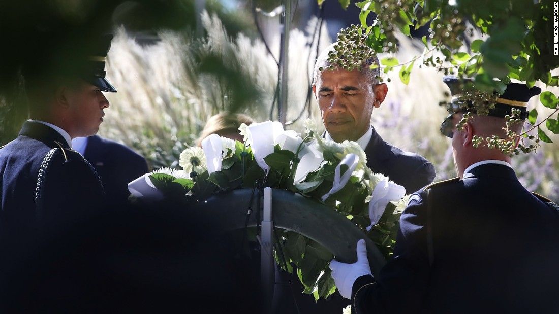 President Barack Obama lays a wreath during a ceremony Sunday at the Pentagon Memorial to mark the 15th anniversary of the 9/11 terrorist attacks.