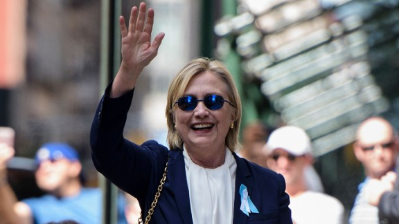 US Democratic presidential nominee Hillary Clinton waves to the press as she leaves her daughter